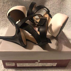 Breckelle's black & white strap heels